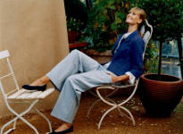 Right -Laura Ashley Spring/Summer 2006 Fashion Atlantis blue swing jacket, white cotton blouse & blue & white cotton trousers.  Jacket �55, Blouse �65 & Trousers �60.